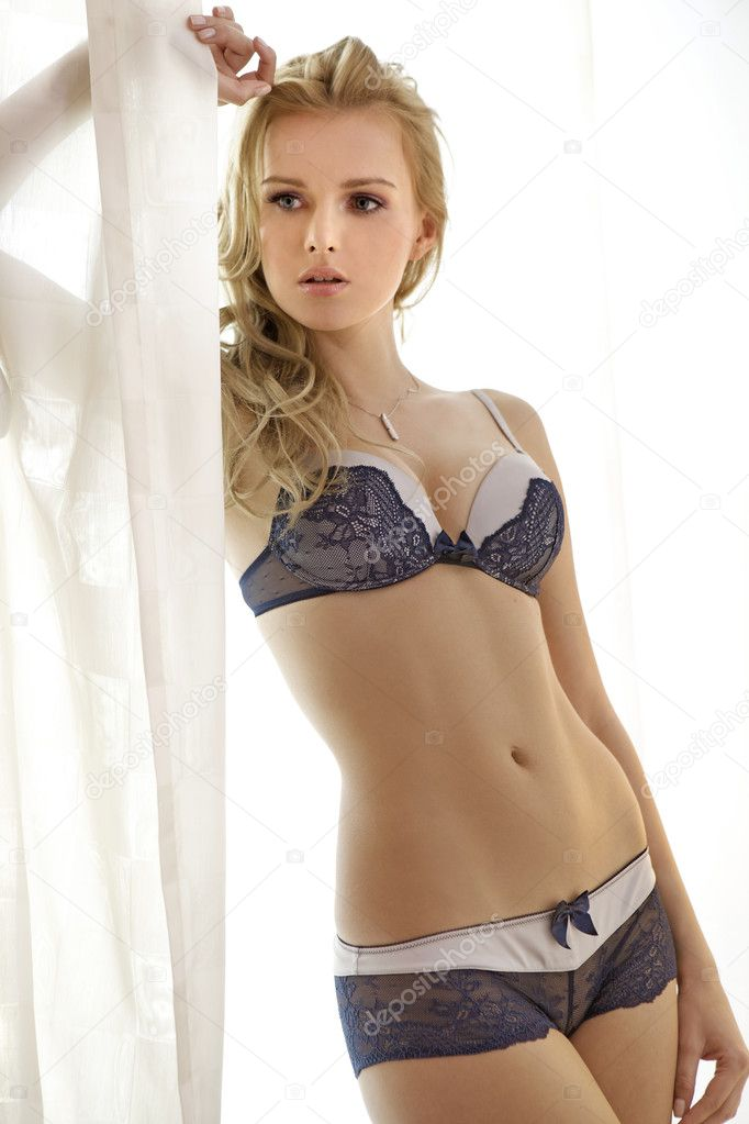 Young sexy blond woman in sexy lingerie — Stock Photo #5595894