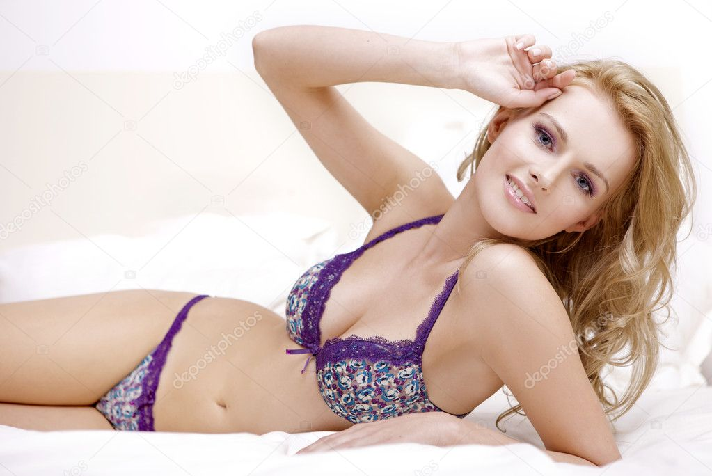 Young sexy blond woman in sexy lingerie — Stock Photo #5735865