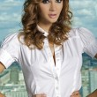 Brunette on the background of the city - Stockfoto