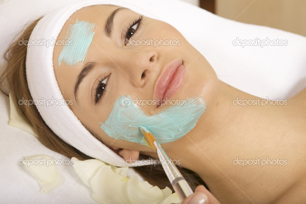 Young woman getting beauty skin mask treatment on her face with brush — Stock Photo #5820086