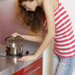 Woman standing at the kitchen — Stock Photo