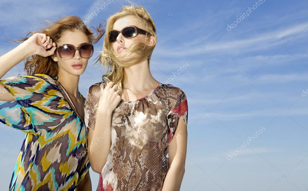 Two beautiful and sensuality girls on the sky background — Stock Photo #5844221