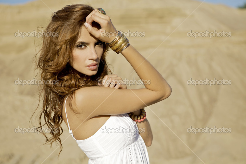 Portrait of a beautiful adult sensuality and attractive woman in sand background desert — Stock Photo #5864088