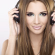 Beautiful girl is listen to the music — Stock Photo #6011448