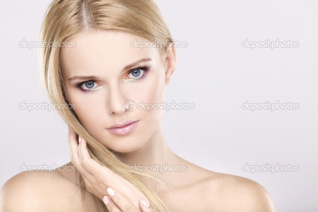 Young pretty woman with beautiful blond hairs and multicolor makeup isolated on white background — Stock Photo #6011377