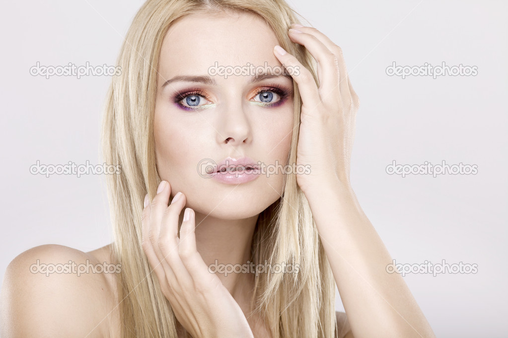 Young pretty woman with beautiful blond hairs and multicolor makeup isolated on white background — Stock Photo #6024886