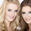 Two smiling girls friends - blond and brunette - Stock Photo