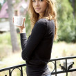 Portrait of cute teenage girl with cup of coffee — Stok fotoğraf