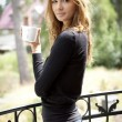 Portrait of cute teenage girl with cup of coffee — ストック写真