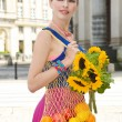Stock Photo: Woman holding shopping bags against