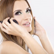 Beautiful girl is listen to the music — Stock Photo #6645235