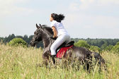 Girl on horseback — Stock Photo