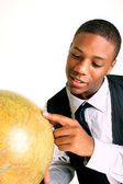 Man holding globe with a smile — Stock Photo