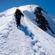 Climbers groups on Mont Blanc massif - Stock Photo