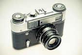 Old photography camera in vintage style — Stock Photo
