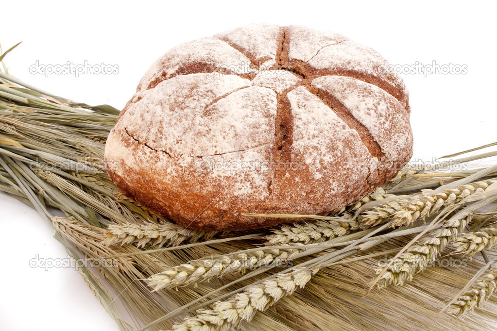 Bread on grain against a white background — Stock Photo #5955006