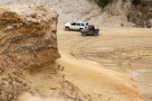 Off road driving in a sand pit — Stock Photo