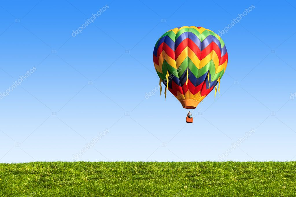Hot air balloon over blue sky  Stock Photo #6376649