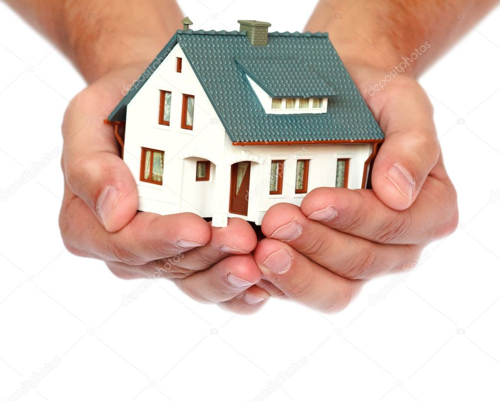 Miniature house in hands  Stock Photo #6679229