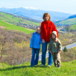 Tourist family and spring mountain country valley view — Stock fotografie