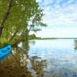 Boat near the summer lake shore — Stock Photo