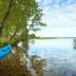 Stock Photo: Boat near the summer lake shore