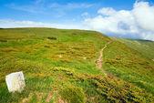 Stony post on summer mountain ridge — Stock Photo
