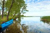 Boat near the summer lake shore — Stock Photo