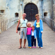 Evening Svirzh  (Ukraine) Castle entrance gate and family near. — Stock Photo