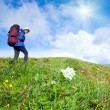 Womwith tourist knapsack on mountain — Stock Photo #6256540