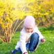 Small girl in spring park - Stock Photo