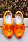 Wooden classic dutch clog shoes . — Stock Photo