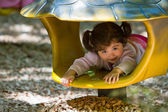 Toddler playing in playground toy — Stock Photo