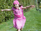 Young girl running and flying — Stock Photo