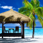 Tropical gazebo with chairs on amazing beach — Stock Photo