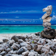 Stack of reef stones on a sky and lagoon - Stock Photo