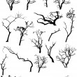 图库矢量图片: Scary Dead Trees Silhouettes Collection