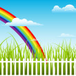 Beautiful Rainbow Behind Green Grass — Stock Vector