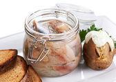 Herring salt fillet in the glass jar — Stock Photo