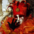 Stock Photo: Venice carnival, orange jester