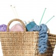 Overflowing knitter's basket, isolated on white — Stock Photo