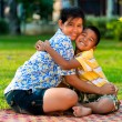 Stock Photo: Mother and son play in park