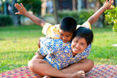 Mother and son play in a park — Stock Photo
