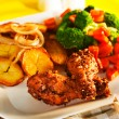 图库照片: Fried potatoes broccoli carrots and roasted chicken
