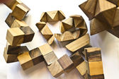 Wooden puzzles on an white background — Stock Photo