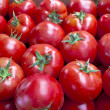 Royalty-Free Stock Photo: A background of fresh tomatoes for sale at a green market