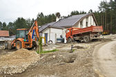 Excavator on site working,road repair,building house — Stock Photo