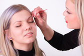 Makeup artist at work — Stock Photo