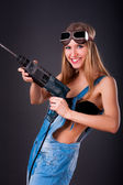 Girl with a drill — Stock Photo