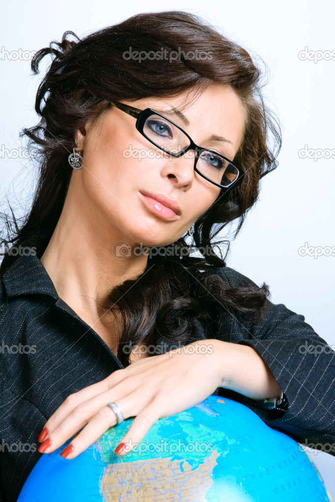 Young sexy beautiful business woman agains the globe — Stock Photo #5806443